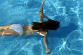 Woman underwater — Stock Photo