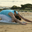 Yoga exercise on the beach — Stock Photo