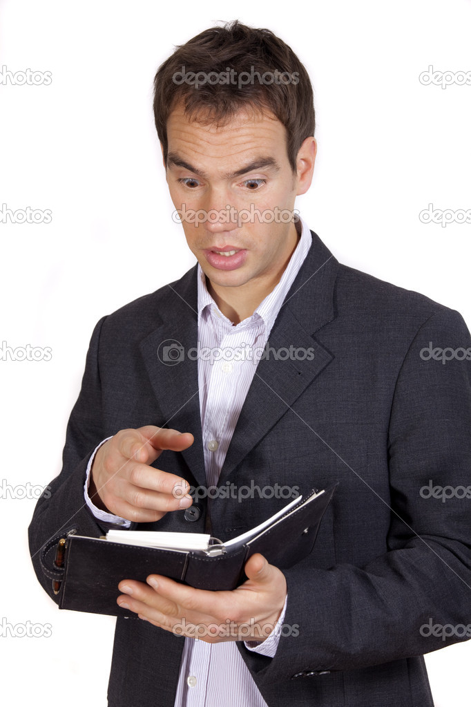 Surprised businessman holding diary on a white background — Stock Photo #1199392