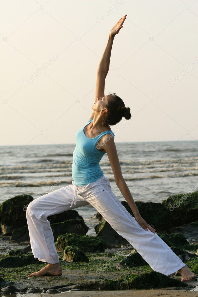 Woman doing yoga exercises at the beach — Stock Photo #1199623