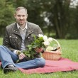 Man with flowers waiting — Stock Photo