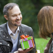 Man holding gift box — Stock Photo