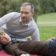 Relaxing couple in park — Stock Photo