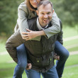 Man carrying woman — Stock Photo
