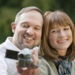 Couple outdoor with video camera — Stock Photo