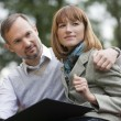 Romantic couple in park — Stock Photo