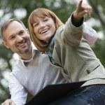 Happy couple with photo album — Stock Photo #1233430