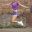Fitness woman jumps — Stock Photo