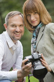 Man and woman with photo camera — Stock Photo