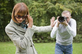Paparazzi takes a picture from woman — Stock Photo