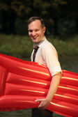 Happy man with air mattress — Stock Photo