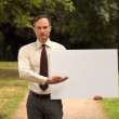 Businessman with blank board — Stock Photo #1240346