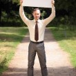 Stock Photo: Mholding blank bulletin board
