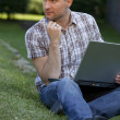 thinking man with laptop — Stock Photo