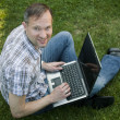 Man with laptop outdoor — Stock Photo #1240779
