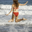 Woman jumping on the beach — Stock Photo #1241413