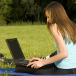 Female student working with laptop outdo — Stock Photo
