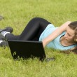 Woman with laptop outdoor — Stock Photo