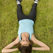 Woman relaxing on grass — Stock Photo #1242061