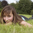 Stock Photo: Woman relaxing on grass