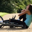 Stock Photo: Accident on road with biker