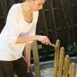 Painting wooden fence — Stock Photo #1243182