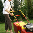 Woman mowing grass — Stock Photo #1243199
