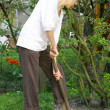 Woman with shovel — Stock Photo #1243245