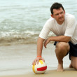 Man with volleyball on the beach — Stock Photo