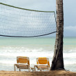 Chaises and Volley net on the beach — Stock Photo
