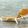 Chaise longue in water - Stock Photo