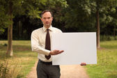 Businessman with blank board — Stock Photo