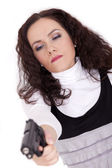 Woman with gun aiming — Stock Photo