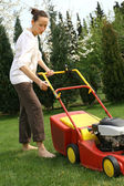 Woman mowing grass — Stock Photo