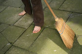 Sweeping with broomstick — Stock Photo