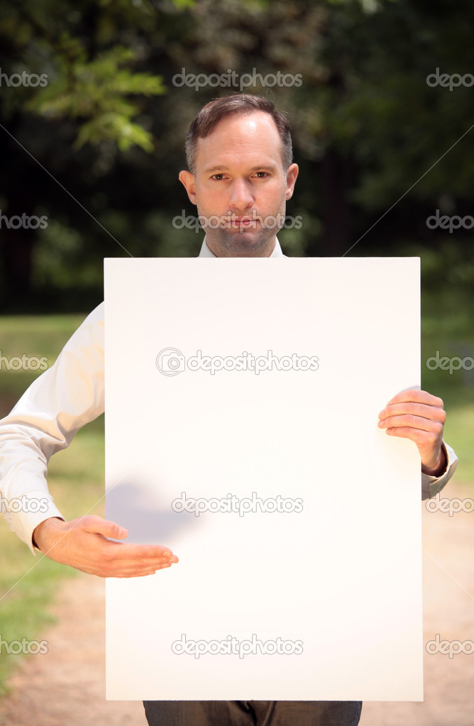 Businessman with a blank board to write your own message  Stock Photo #1240374