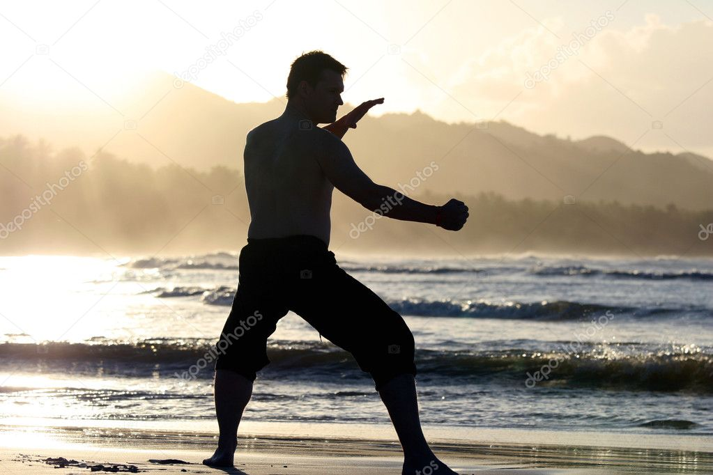 Man ready for fight on the beach by sunset  — Stock Photo #1248478