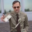 Man throwing the money — Stock Photo