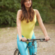 Active woman on cycle - Stock Photo
