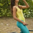 Thirsty fitness woman — Stock Photo