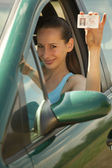 Woman with driving permit — Stock Photo