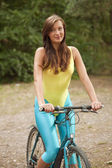 Active woman on cycle — Stock Photo
