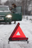 Warning triangle with car on road — 图库照片