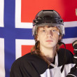 Ice hockey player over norwegian flag — Stock Photo