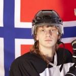Ice hockey player over norwegian flag — Stock Photo
