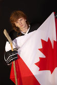 Hockey player with canadian flag — Stock Photo