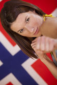 Fighting woman over norwegian flag — Stock Photo