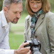 Photographer showing pictures — Stock Photo #1596386