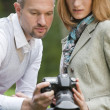 Couple holding photo camera — Stock Photo