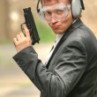 Stock Photo: Male agent with gun